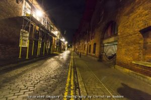 Image of a cobbled street at night